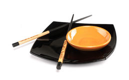 Sushi plates and chopsticks Royalty Free Stock Photo