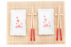 Sushi plates and chopsticks on bamboo mat Stock Photography
