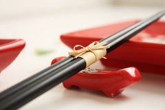 Sushi plates with chopsticks on the white table Stock Photos
