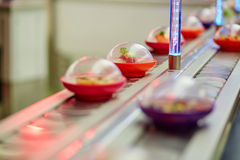 Sushi plates on rails in Japanese restaurant Royalty Free Stock Photography