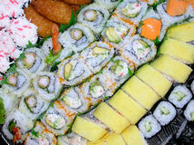 Sushi Platter. A platter of various kinds of sushi...shrimp tempura, california rolls, salmon rolls, cucumber rolls, and the house special Stock Photo
