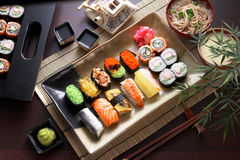 Sushi platter. A plate of different combination of sushi with a bowl of soba