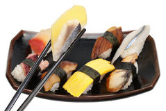 Sushi Platter Meal. A small platter of sushi with chopsticks grabbing a piece of saba kazunoko (mackerel and roe Royalty Free Stock Photos