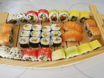 Sushi on a platter. Several kinds of sushi on a wooden platter Royalty Free Stock Photo