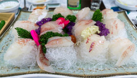 Sushi platter. On top of sliced radishes and decorated with leaves Royalty Free Stock Photos