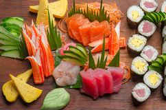 Sushi platter on a wooden board royalty free stock images
