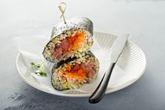 Sushi or poke burrito with nori. Sheet, raw tuna and vegetables Stock Photo