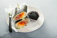 Sushi or poke burrito with nori. Sheet, raw tuna and vegetables Stock Photos