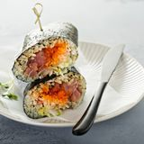 Sushi or poke burrito with nori. Sheet, raw tuna and vegetables Stock Images