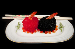 Sushi with prawns, red and black fish eggs. Royalty Free Stock Photo
