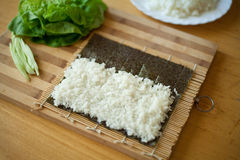 Sushi preparation rice Royalty Free Stock Image