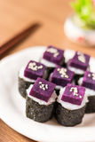 Sushi. Purple sweet potato in  rice with white ceramic plate. The benefits of purple sweet potato are high Beta Carotene and Carbohydrate used in cooking Stock Photography