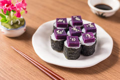 Sushi. Purple sweet potato in  rice with white ceramic plate. The benefits of purple sweet potato are high Beta Carotene and Carbohydrate used in cooking Stock Images
