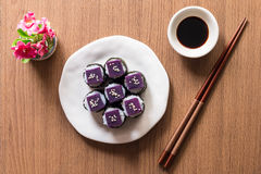 Sushi. Purple sweet potato in  rice with white ceramic plate. The benefits of purple sweet potato are high Beta Carotene and Carbohydrate used in cooking. Top Stock Photo