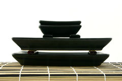 Sushi pyramid. Sushi dishes put on each other laying on mat (perpendicular view Stock Image