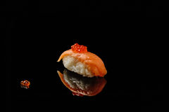 Sushi and red caviar on black acryle with reflection. Sushi and red caviar of salmons on black acryle with reflection Stock Photography