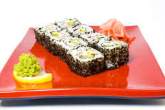 Sushi on a red plate. Isolated royalty free stock photos