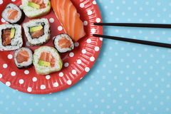 Sushi in a red plate patterned with white dots Stock Images