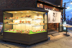 Sushi restaurant in the main road of Otaru, Hokkaido in north Japan, with typical plastic dishes Royalty Free Stock Images