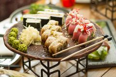 Sushi in a restaurant on the table, selective focus royalty free stock photo