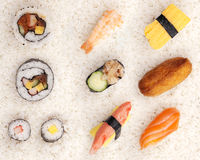 Sushi on rice. Selection of 10 pieces of sushi shot on a white rice background Royalty Free Stock Image