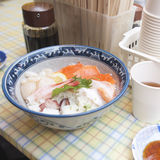 Sushi Rice Bowl filled with Tuna Salmon Prawn and Vegetables Royalty Free Stock Images