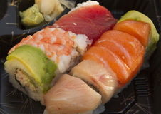 Sushi and Rice. Sushi made with salmon, tuna, and whitefish as a party horderve serving Royalty Free Stock Photography