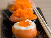Sushi rice wrapped in seaweed and shrimp egg with chopstick Royalty Free Stock Photography