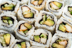 Sushi roll. American-style sushi - California roll with rice, avocado and crab wrapped in seaweed Stock Photo