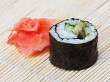 Sushi roll. On a wooden stand Royalty Free Stock Photography