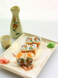 Sushi-roll. On the wooden plate, close-up Royalty Free Stock Image