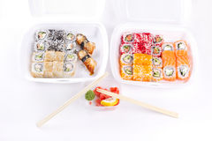 Sushi and roll assortment in containers Royalty Free Stock Photo