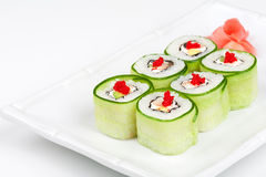 Sushi roll with avocado, cucumber and caviar. Close-up of Sushi roll with avocado, cucumber and caviar Stock Image