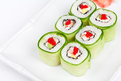 Sushi roll with avocado, cucumber and caviar. Close-up of Sushi roll with avocado, cucumber and caviar Royalty Free Stock Photo