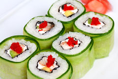 Sushi roll with avocado, cucumber and caviar Stock Photo