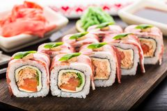 Sushi roll with bacon Stock Images