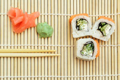 Sushi roll on bamboo mat Stock Images