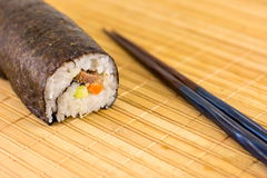 Sushi roll on bamboo tablecloth Royalty Free Stock Image