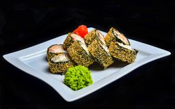 Sushi roll banzai. Hot roll philadelphia with shrimp on a plate royalty free stock images