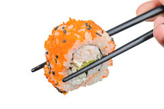 Sushi roll with black chopsticks Royalty Free Stock Photography