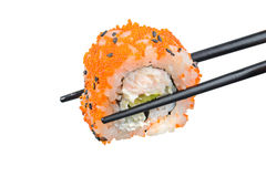 Sushi roll with black chopsticks Royalty Free Stock Image