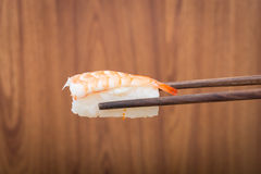 Sushi roll with black chopsticks Royalty Free Stock Photos
