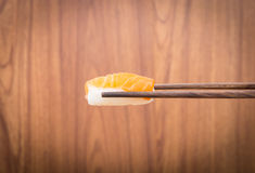 Sushi roll with black chopsticks Royalty Free Stock Photo