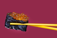 Sushi roll with caviar Stock Photos