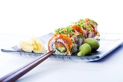 Sushi Roll with Chopsticks Royalty Free Stock Images