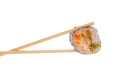 Sushi roll with chopsticks Royalty Free Stock Photos