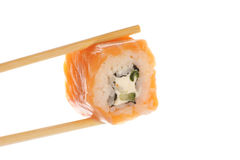 Sushi roll with chopsticks Stock Image