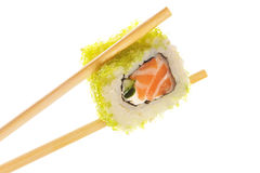 Sushi roll with chopsticks Stock Images