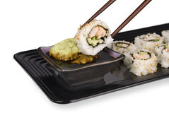 Sushi roll and chopsticks Royalty Free Stock Photo
