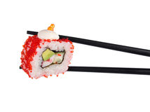 Sushi roll in chopsticks Isolated Royalty Free Stock Photos